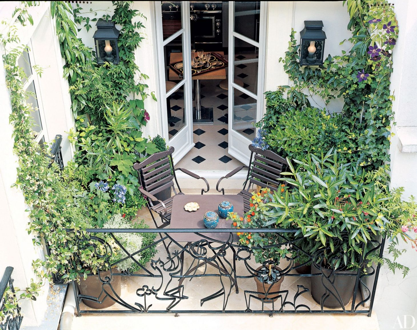 11 Cozy Balcony Ideas and Decor Inspiration | Architectural Digest - balcony decoration ideas with plants
