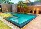 A modern, L.-shaped pool | Backyard pool, Indoor pool design