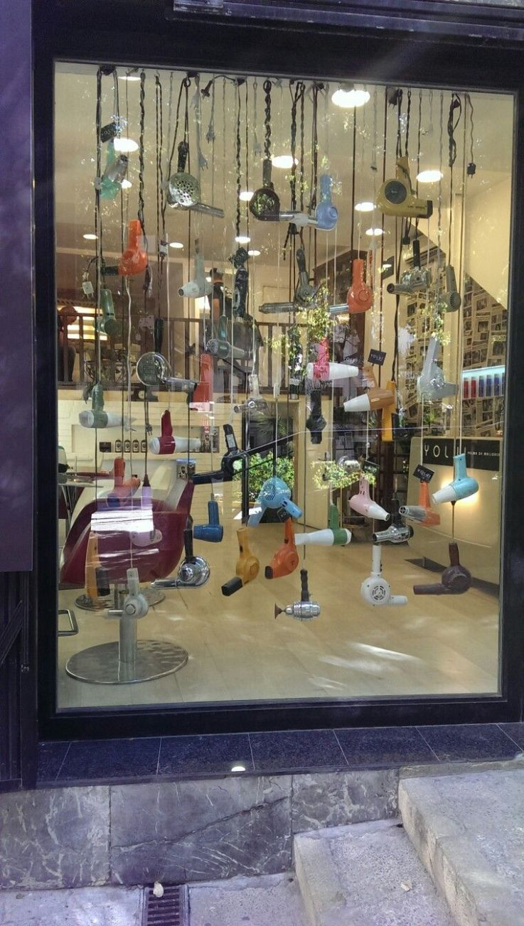 A really interesting window display for a hairdressers, looking at ..