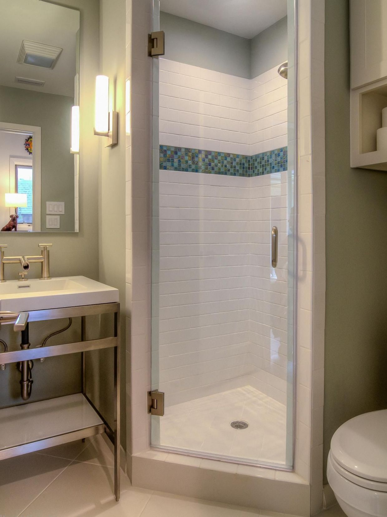 A stall shower fits perfectly in the corner of this small bathroom ..