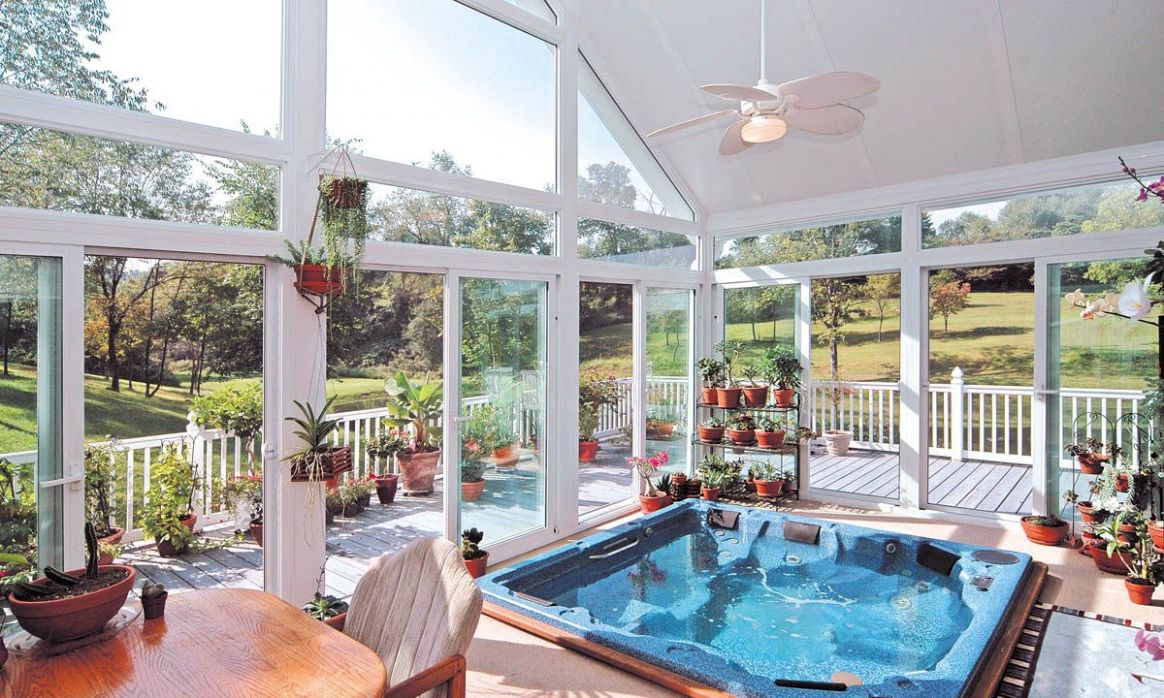 A sunroom lets occupants enjoy an outdoor environment, especially ..