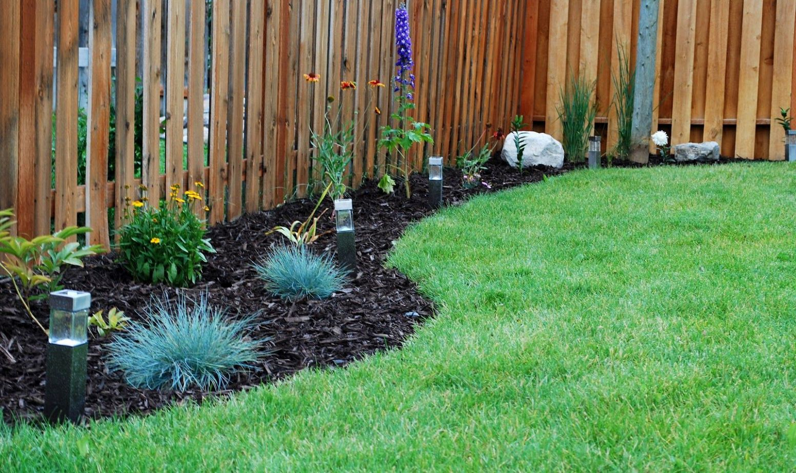 backyard flower bed designs along fence line | Landscaping along ...