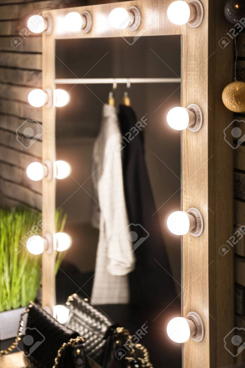 Beautiful mirror with lamps in modern makeup room - makeup room lights