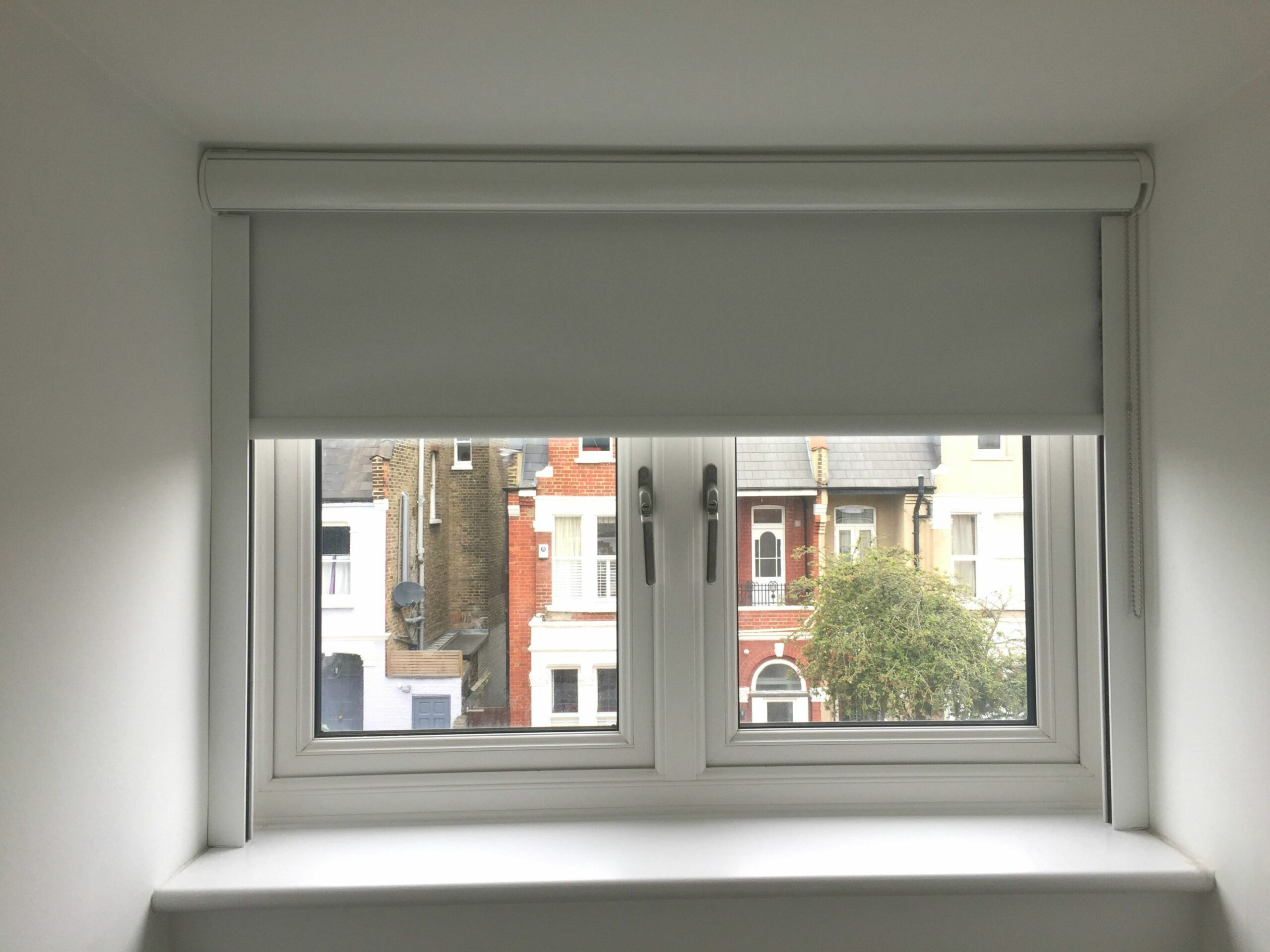 Blackout roller blind in polar white with cassette and side tracks ..