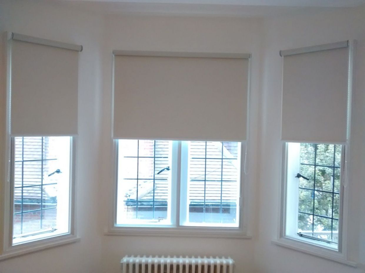 Blackout roller blinds fitted to a bay window | Blinds for windows ...