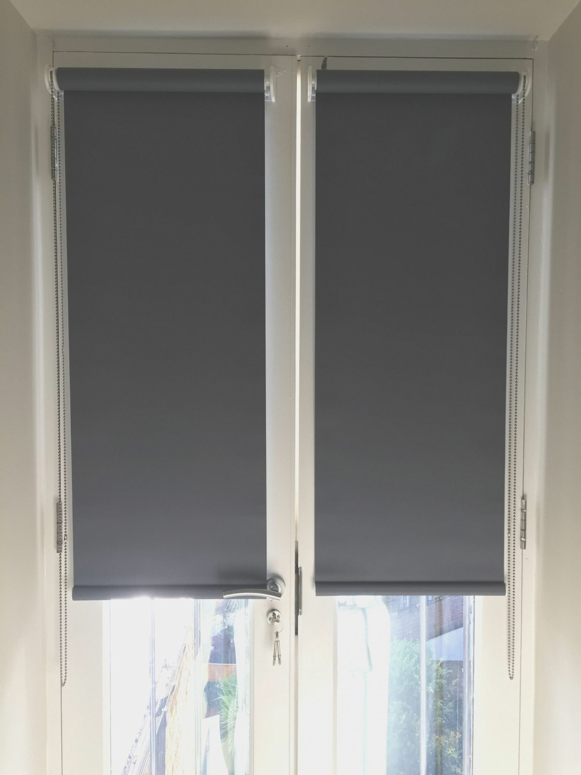 Blackout roller blinds for french doors installed to home in ..
