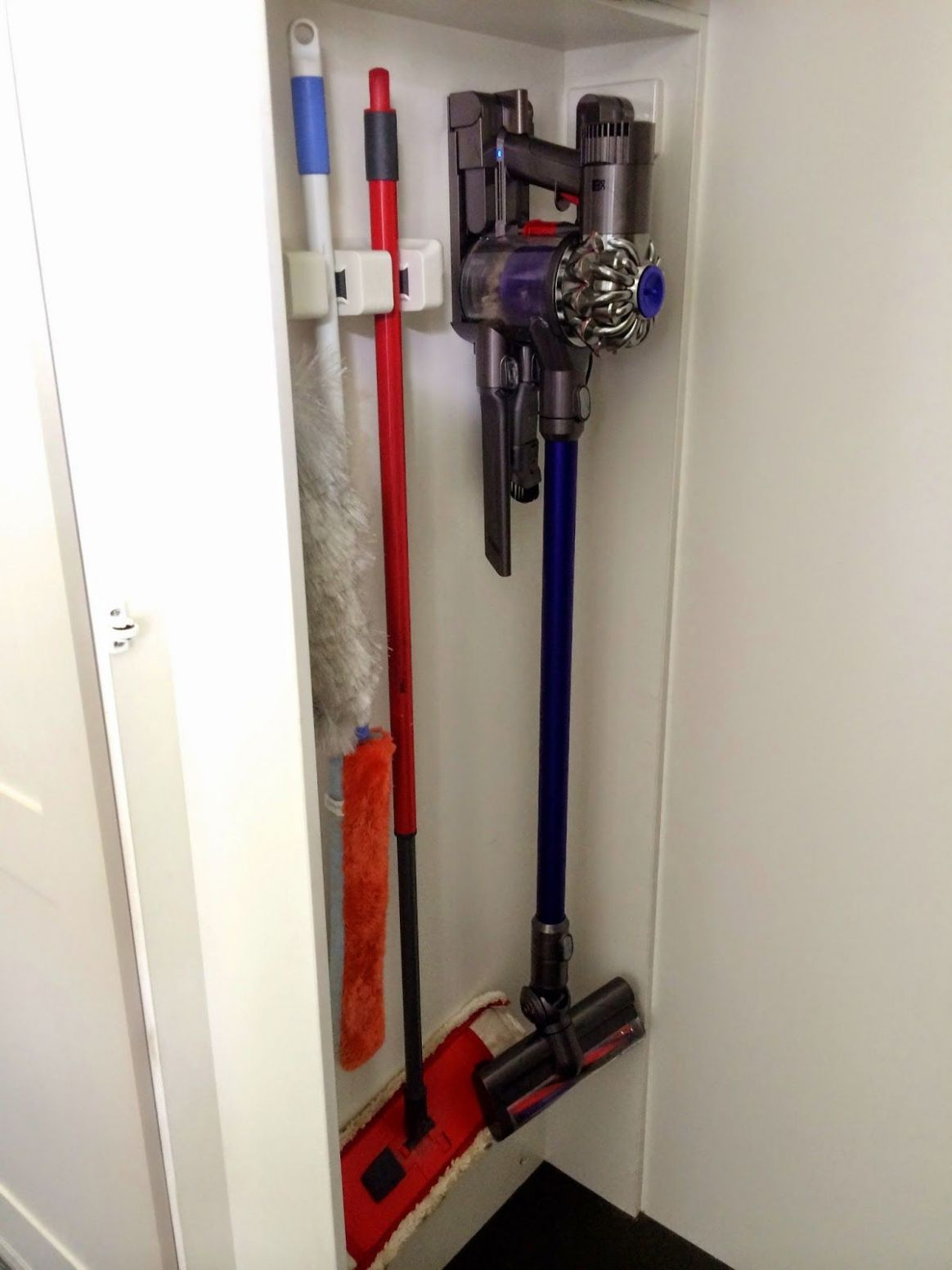 brooms, dusters & dyson storage | Laundry cupboard, Dyson cordless ..