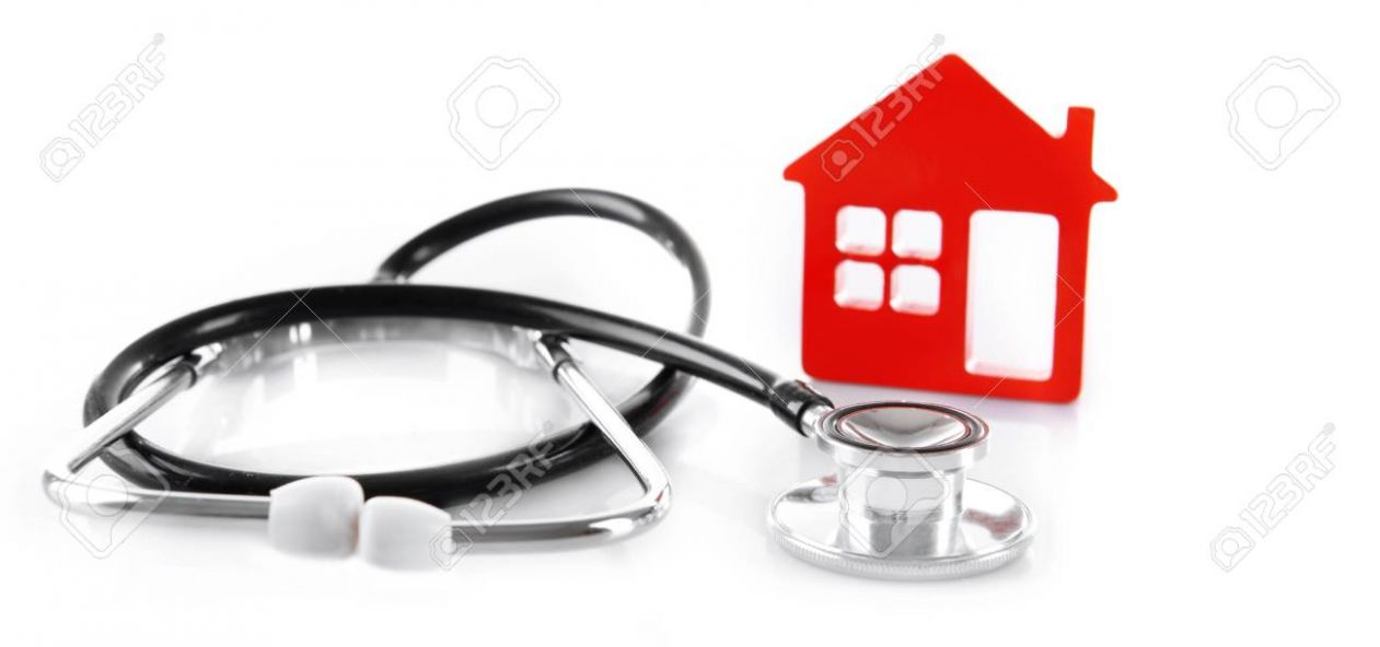 Concept of family medicine - red plastic house and stethoscope.