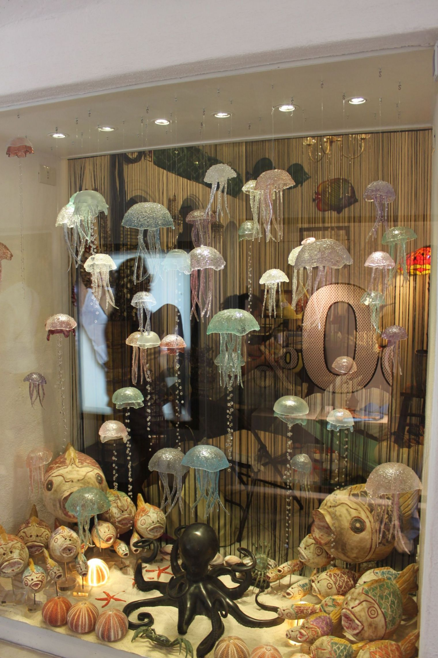 Floating glass jelly fish window display | Window display, Shop ..