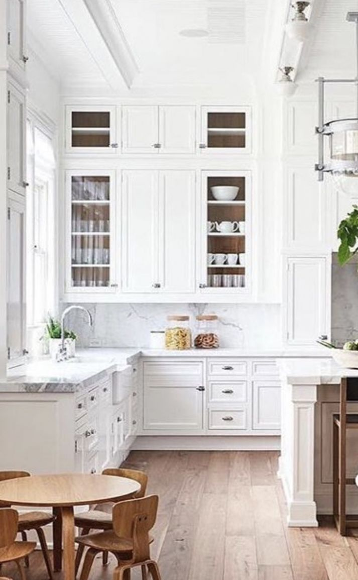 gorgeous white kitchen with super high ceiling and cabinets built ...