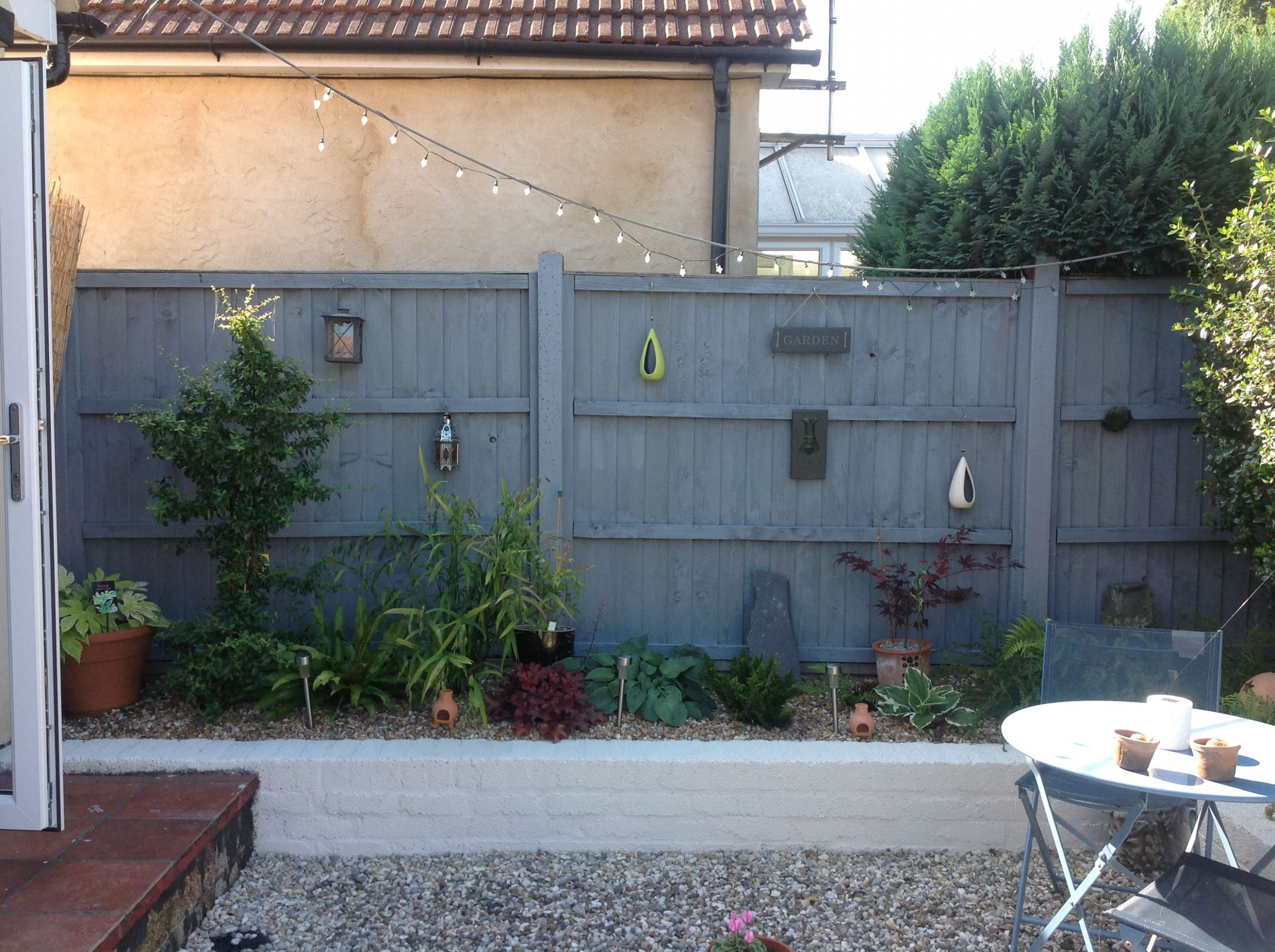 Grey fence/white painted wall | Garden fence paint, Grey fences ...