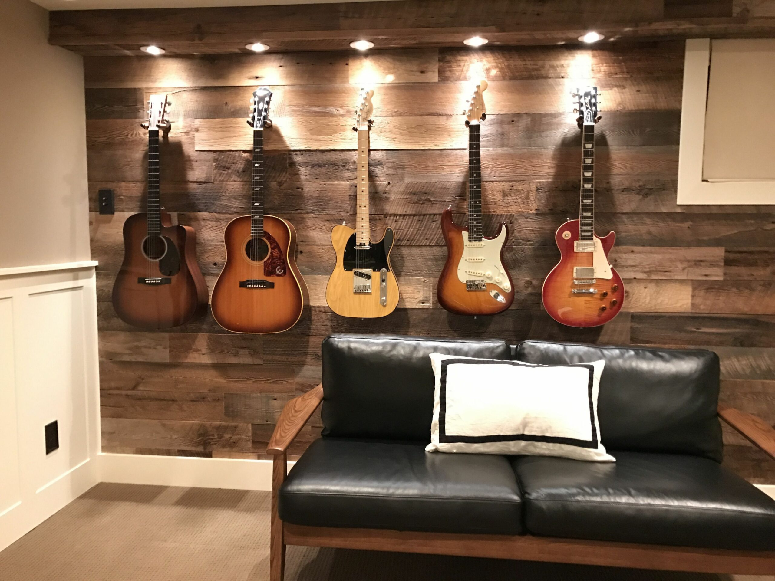 Guitar display wall. I transformed this wall and added spotlights ...