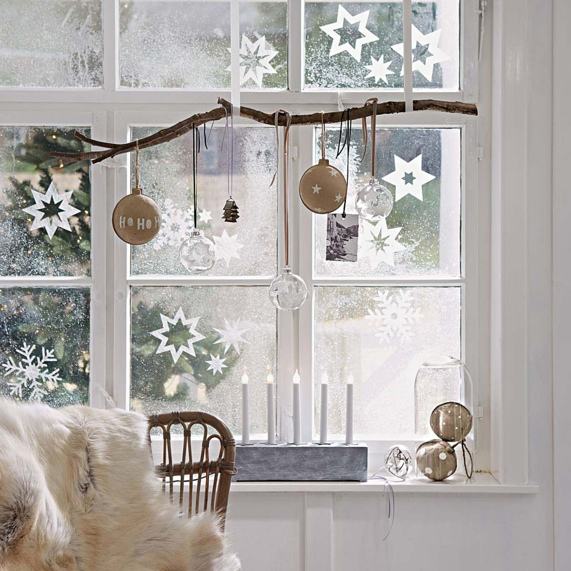 hang a branch in the window with wide ribbon and hang ornaments ...