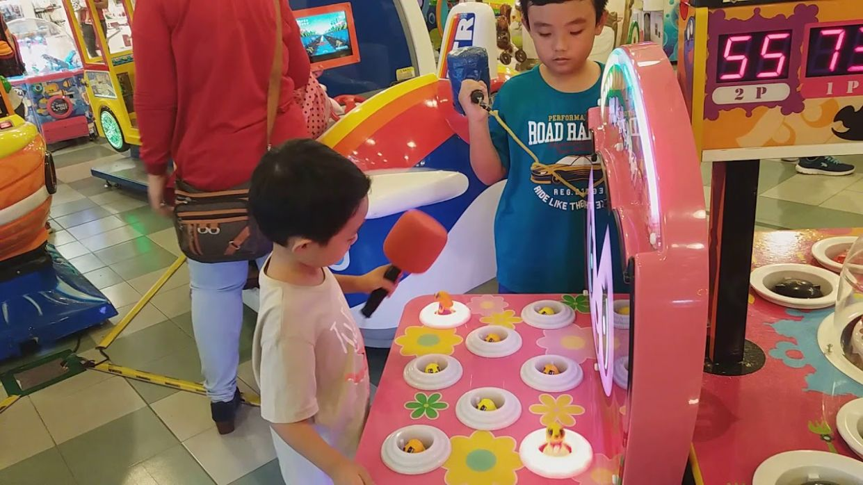 He and his brother whack the doll in Queensbay Mall