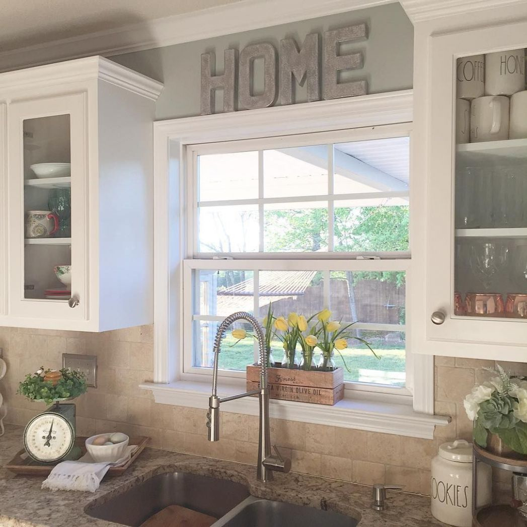 I like the raised window and the glass cabinets around it | Cheap ...