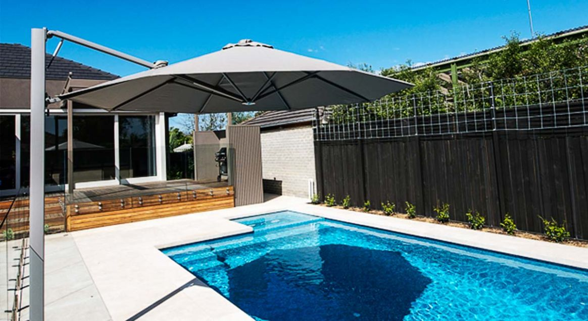 Jump in to these backyard pool ideas for 9 - pool umbrella ideas