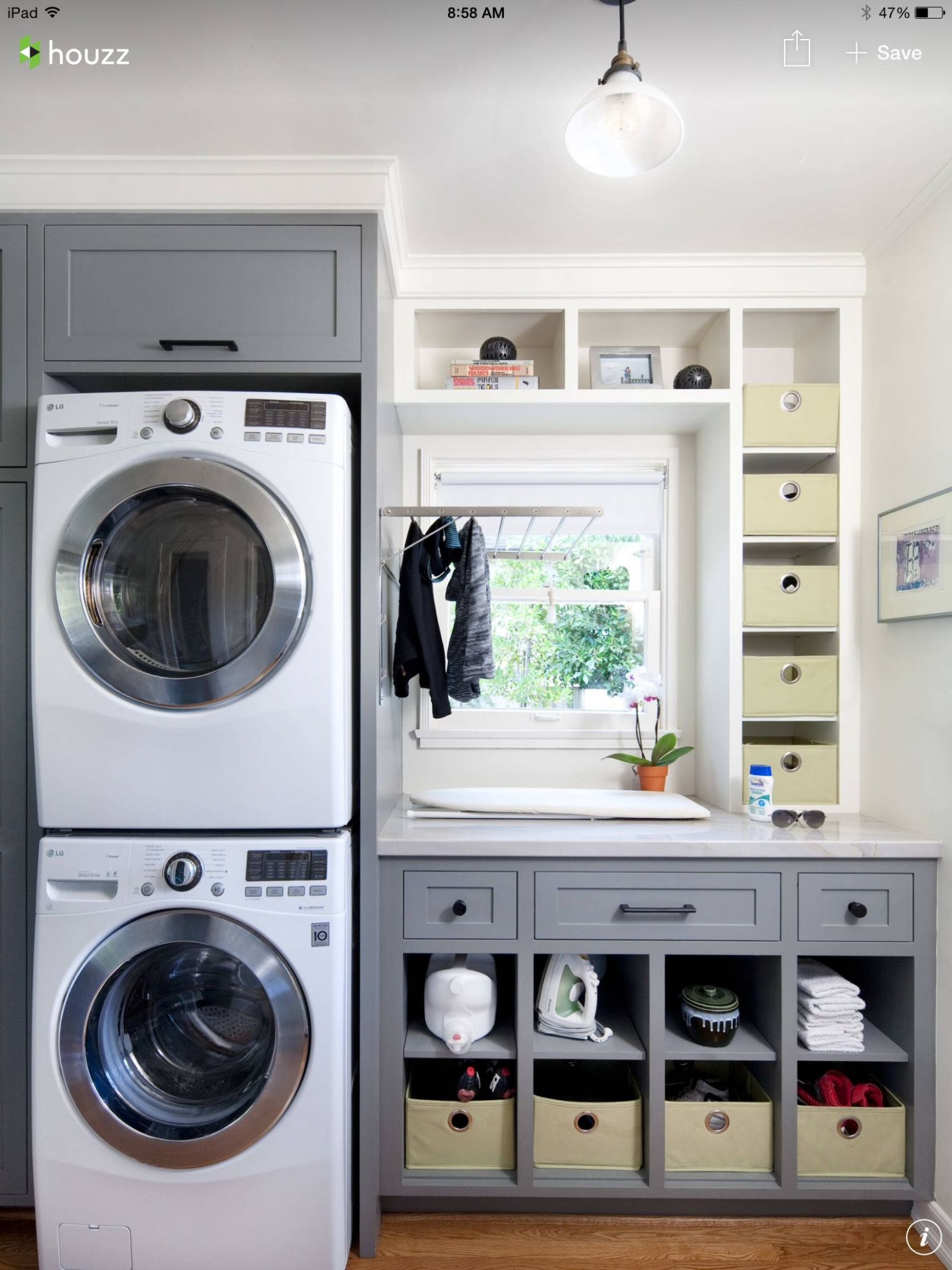 Laundry room- love the pull down drying rack and ironing board ...