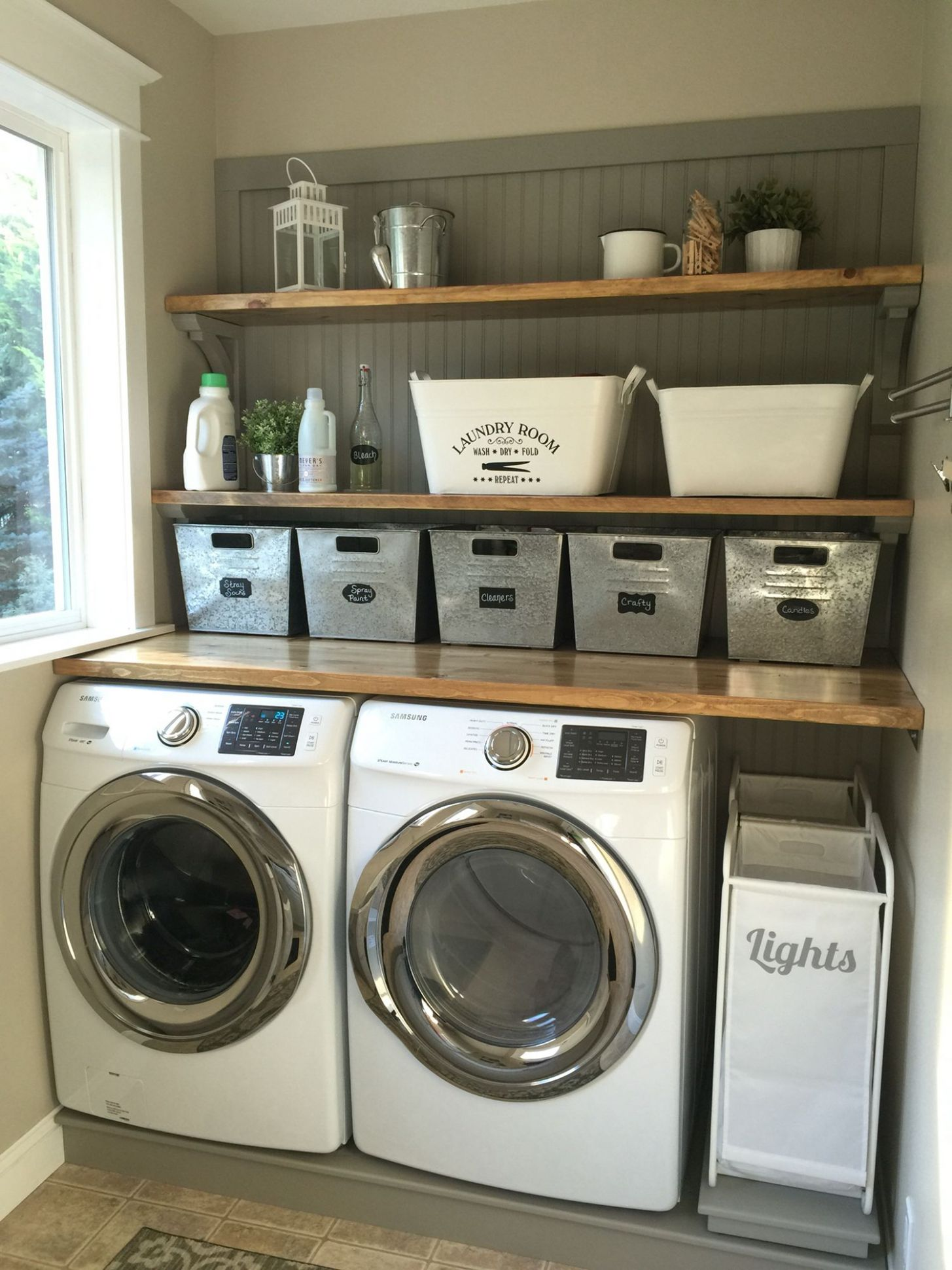 Laundry room makeover. Wood counters, Walmart tin totes, pull out ...