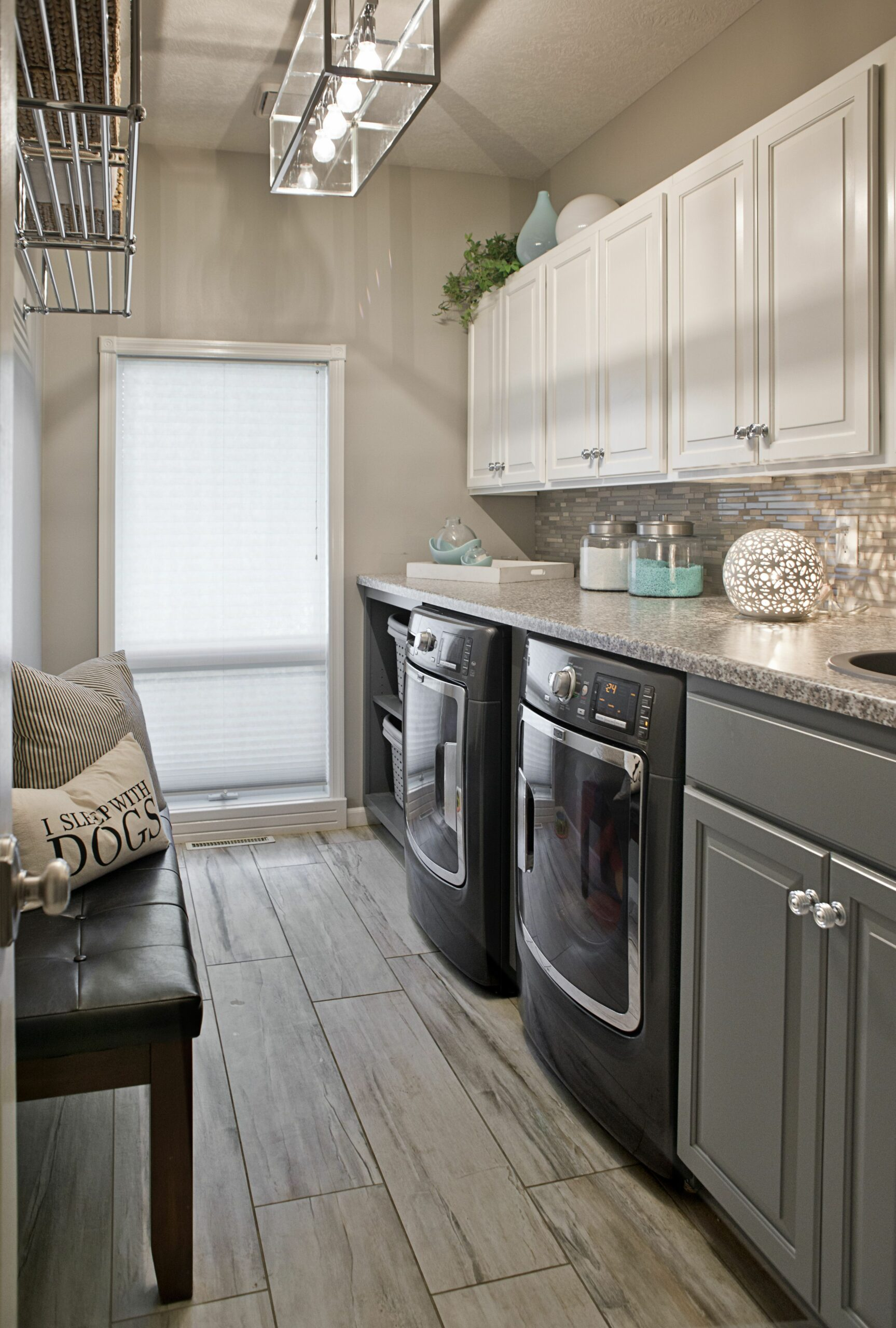 Long Narrow Laundry Room, lots of counter space. Wood look ceramic ...