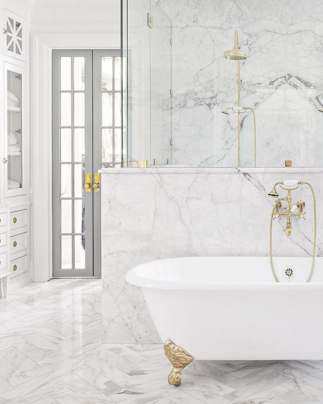 Marble bathroom with white and brass claw-foot tub | White marble ..