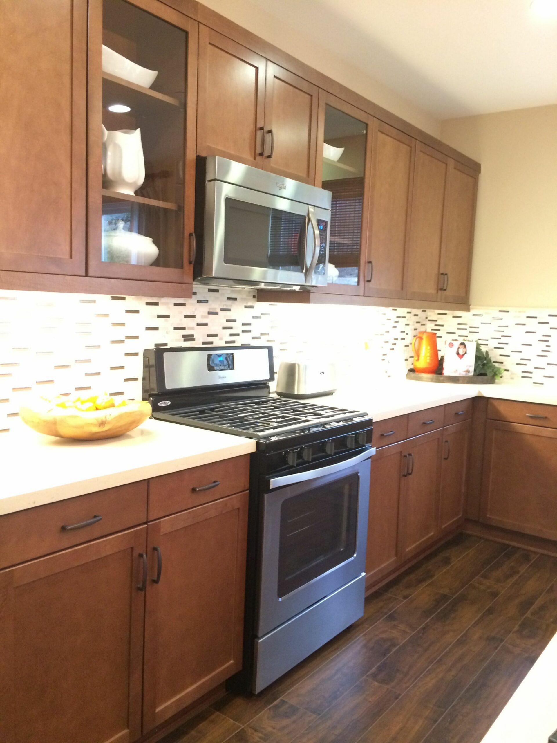 Medium Brown Kitchen Cabinets w/ Light Quartz Countertop and ..