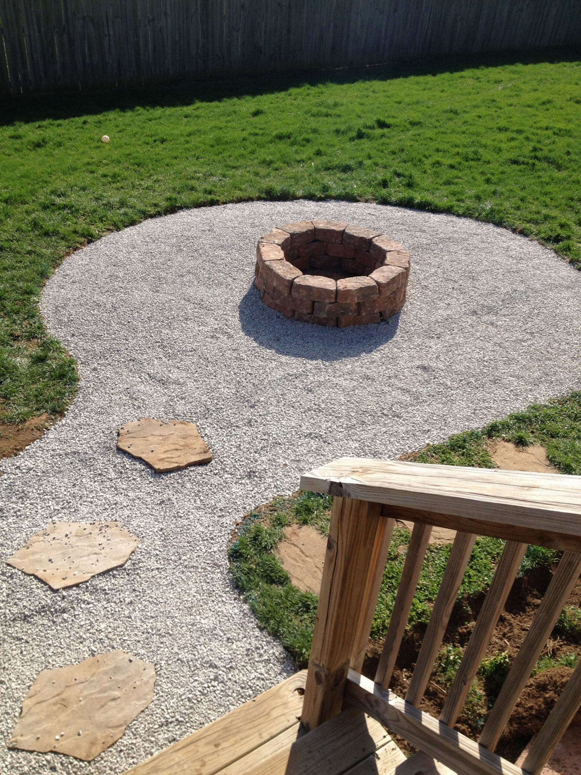 My backyard firepit with seating area. Stones from Lowes $8.85 a ..
