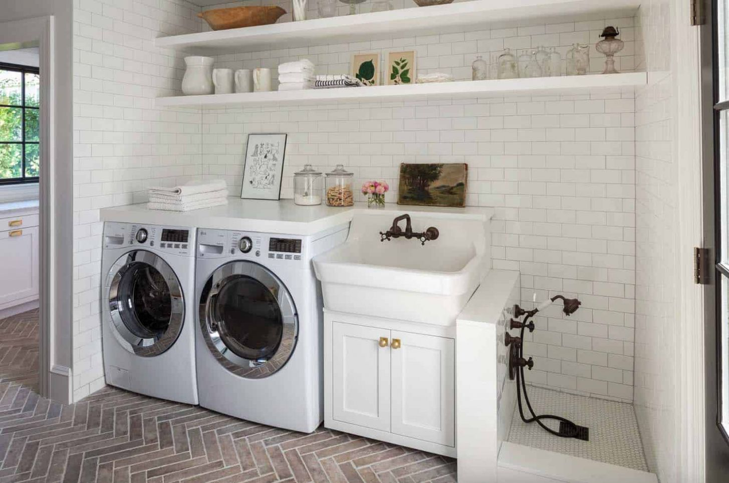 One Kindesign - laundry room ideas with sink