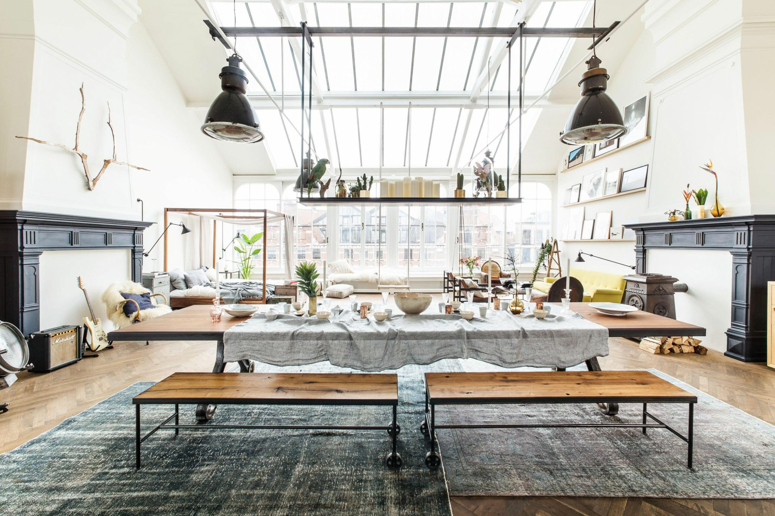 Open studio loft apartment design features large skylight and ...