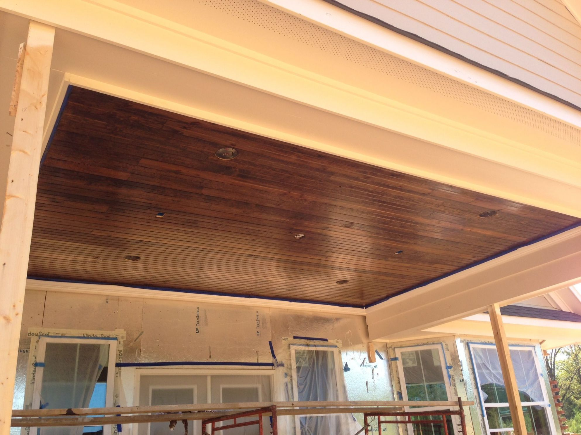 Our patio ceiling! Tongue / groove wood with a dark stain. Love it ..
