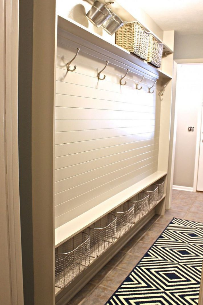 Pool bathroom idea - hooks for towels and baskets for clothes or ..
