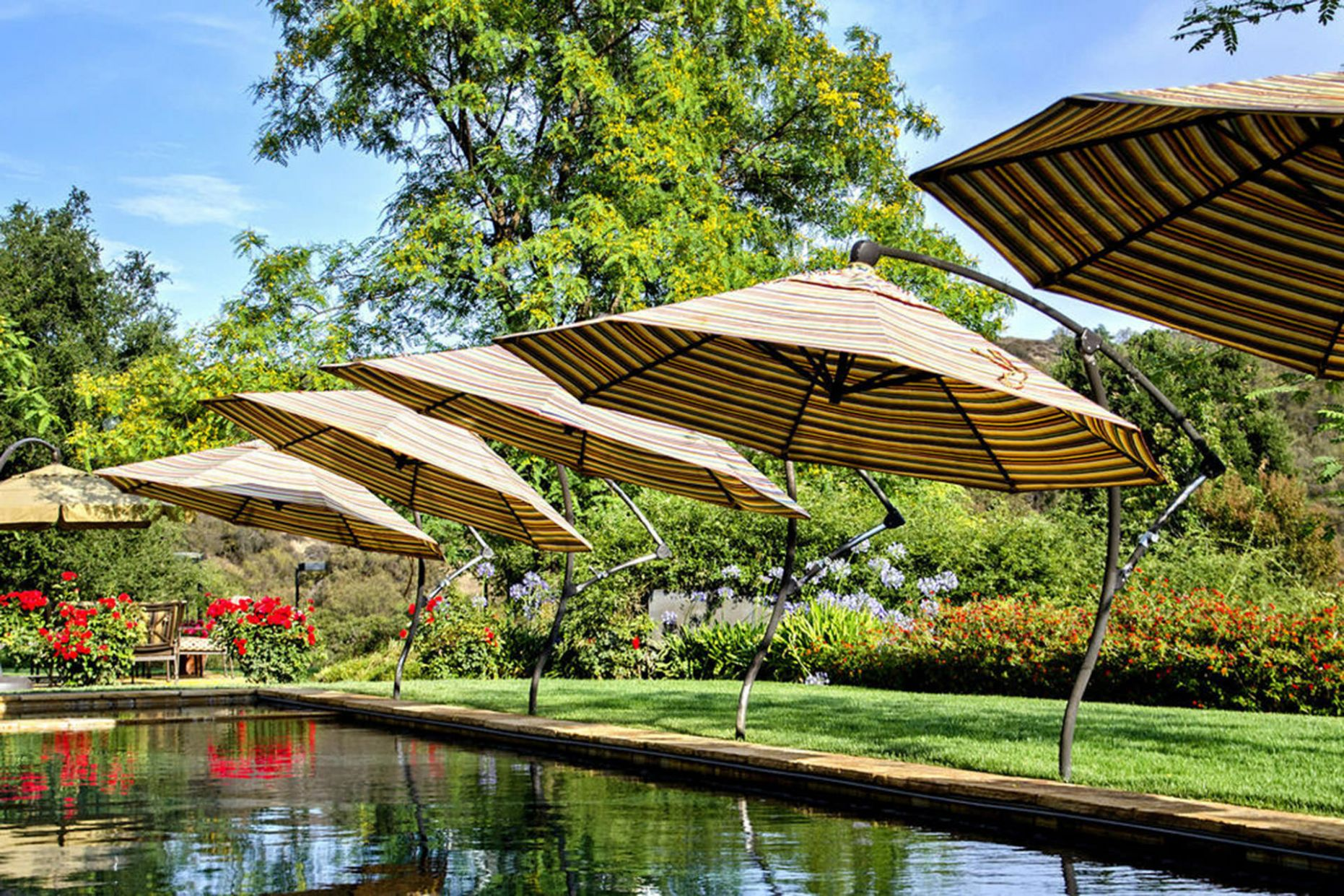 Pool Shade Ideas: 9 Ways to Cover Your Swimming Pool - pool umbrella ideas