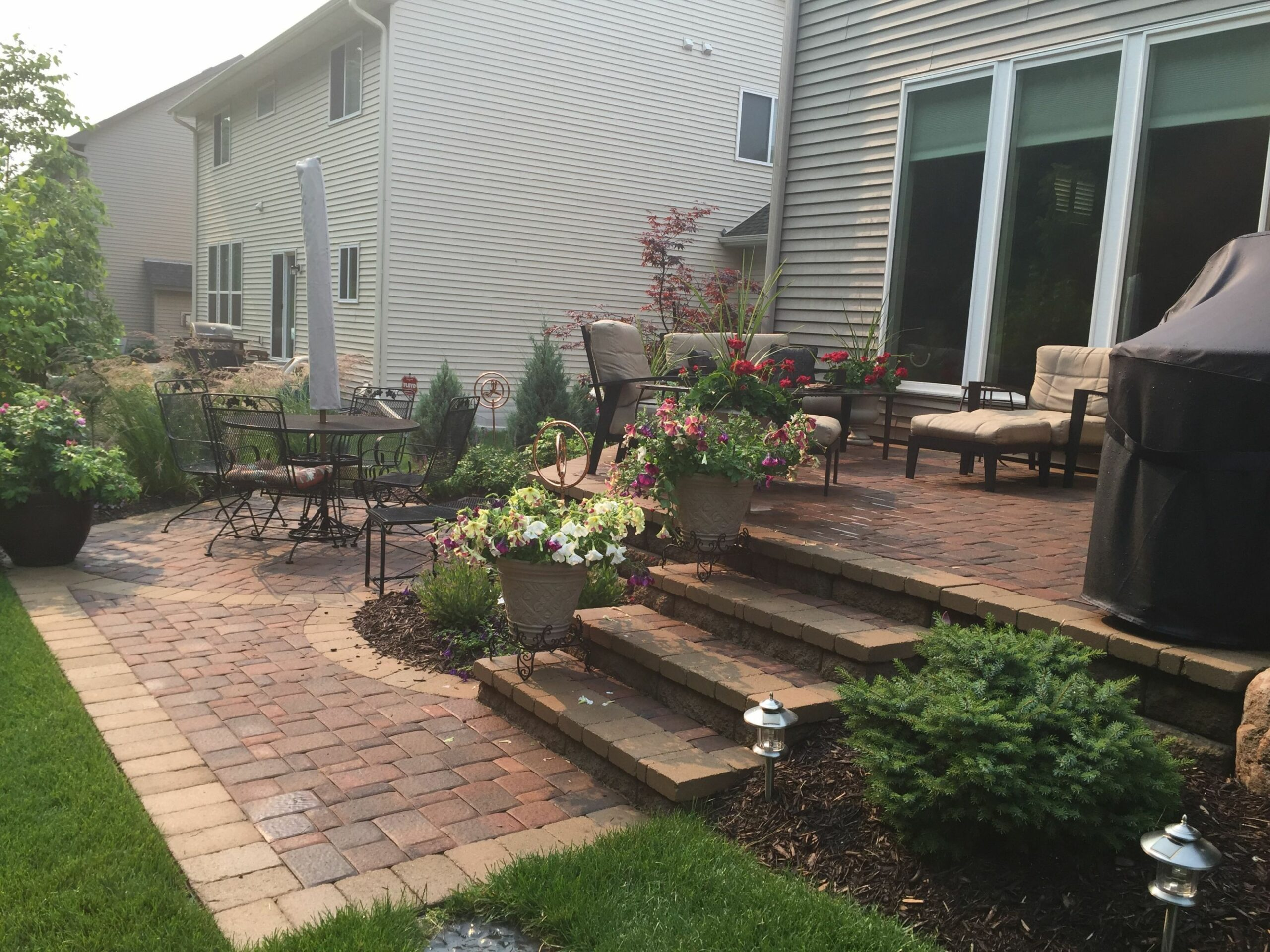 Raised patio with steps down to a second patio space. Two Level ...