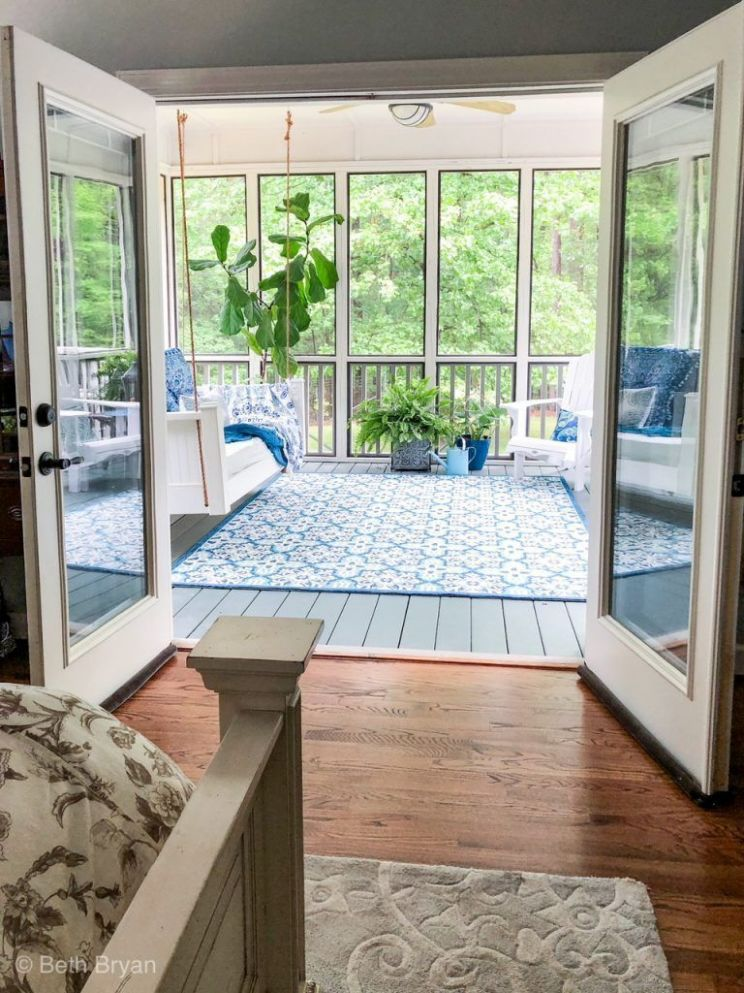 Screened in back porch off master bedroom creates an outdoor room ..