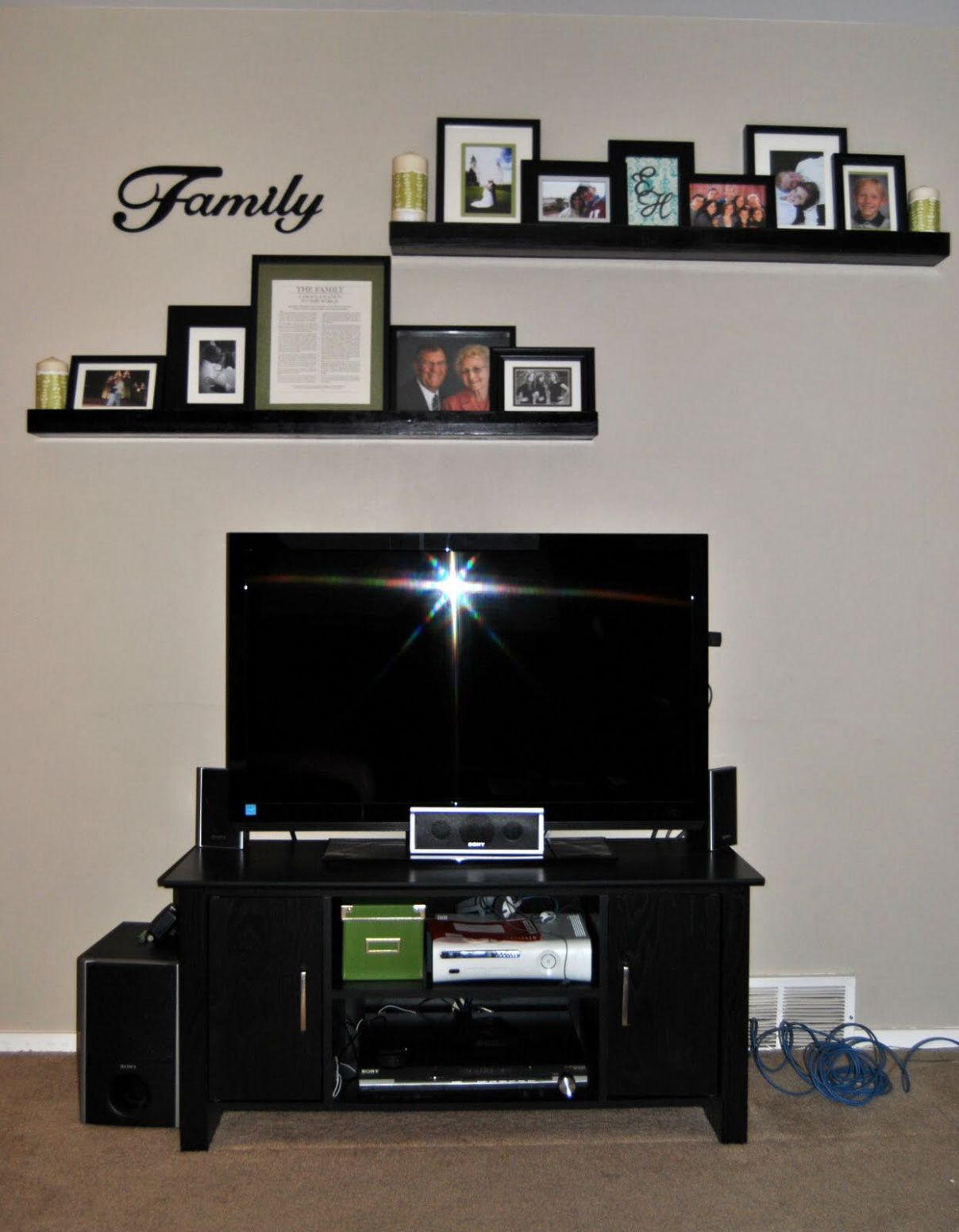 Shelves above tv...don't necessarily like the decor on and around ...
