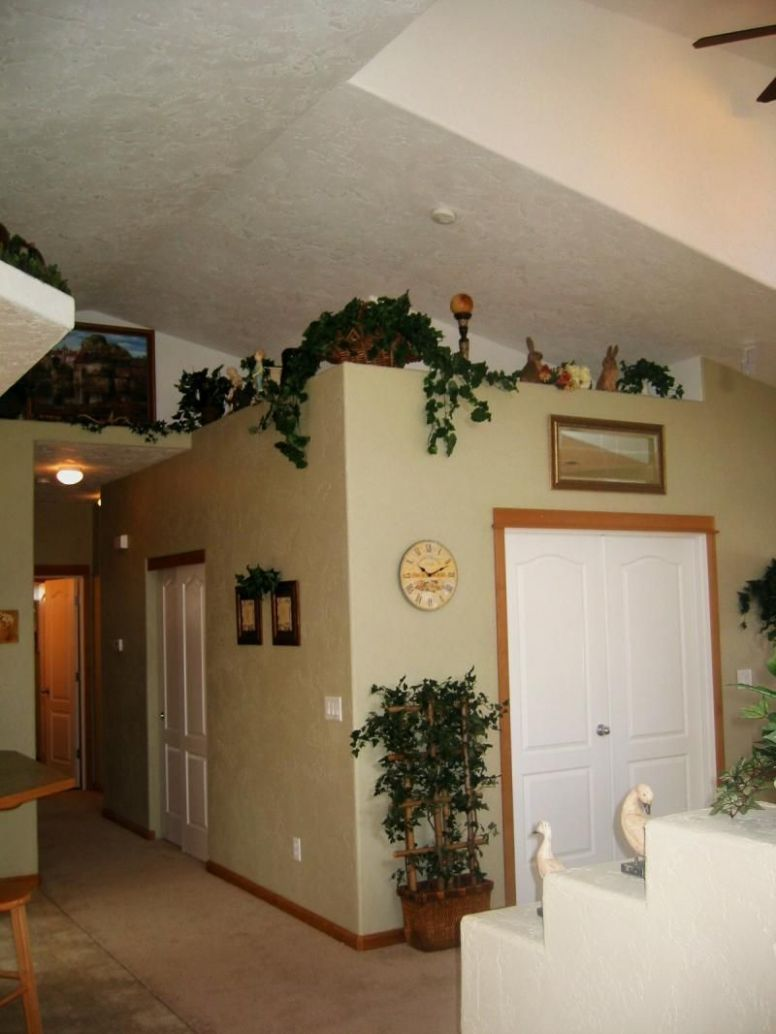 Shows vaulted ceilings in living area with plant shelves for ..