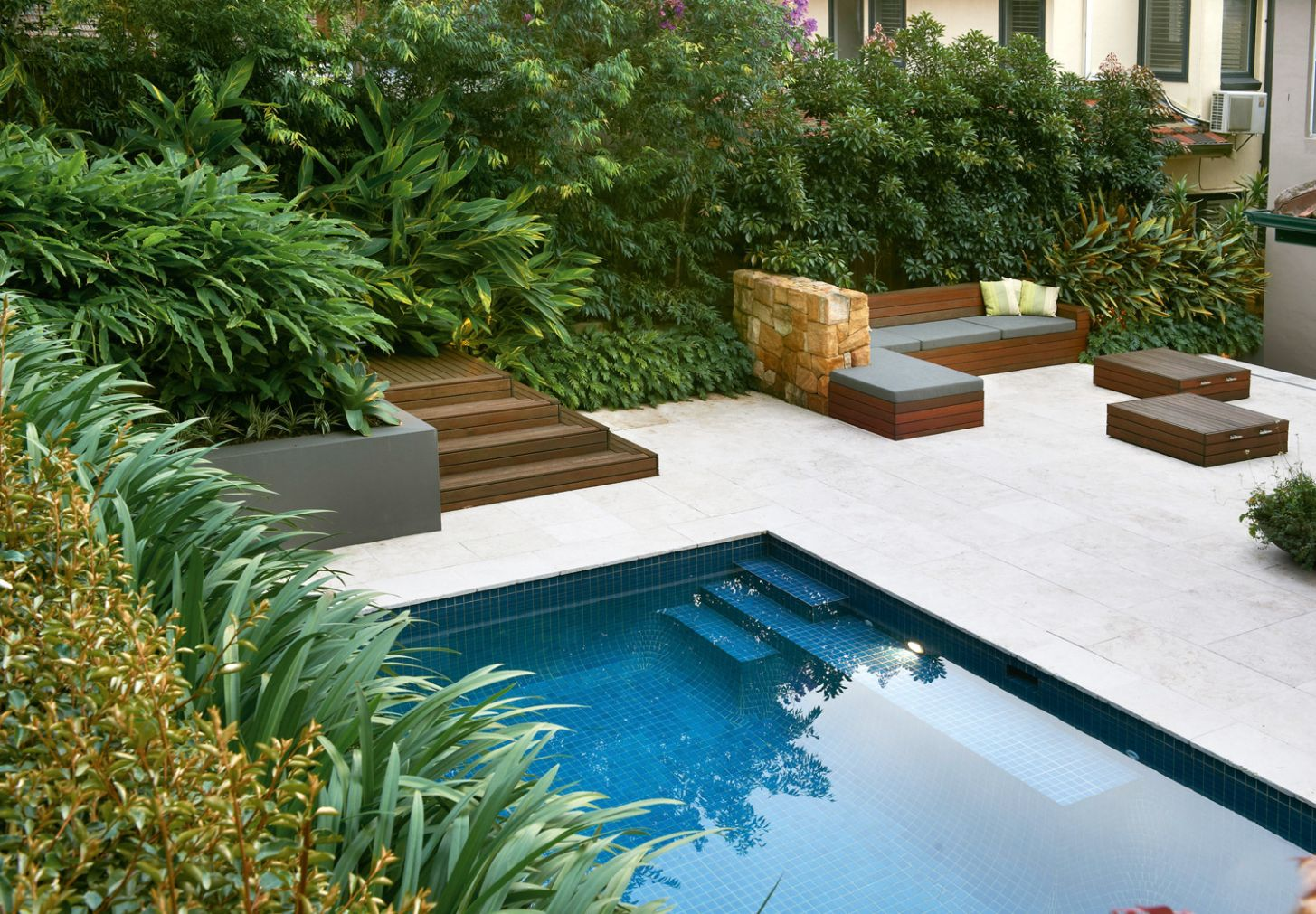 Simply stylish: A classic pool and landscape design - Completehome - pool landscaping ideas queensland