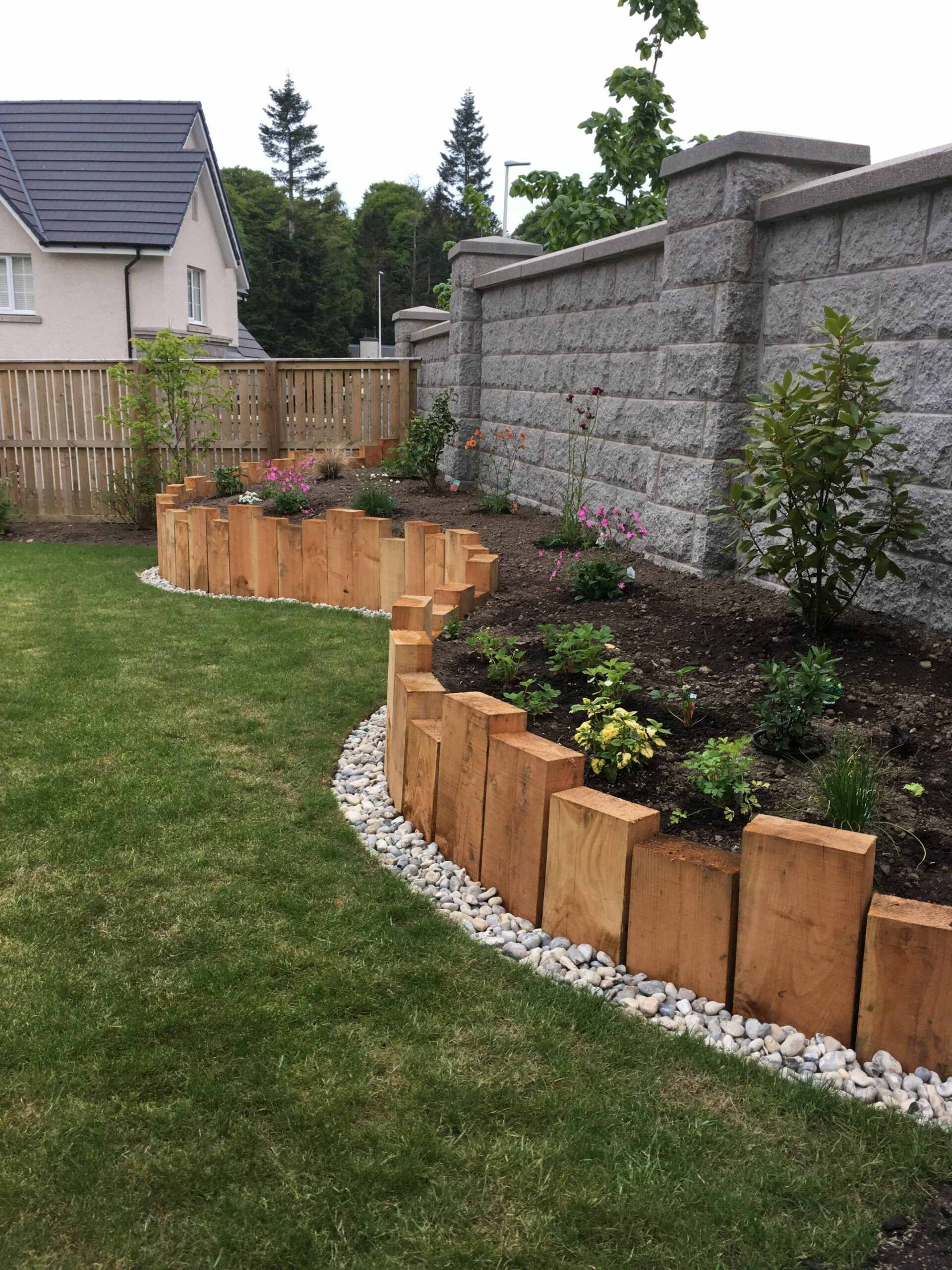 Sleeper raised border | Backyard landscaping designs