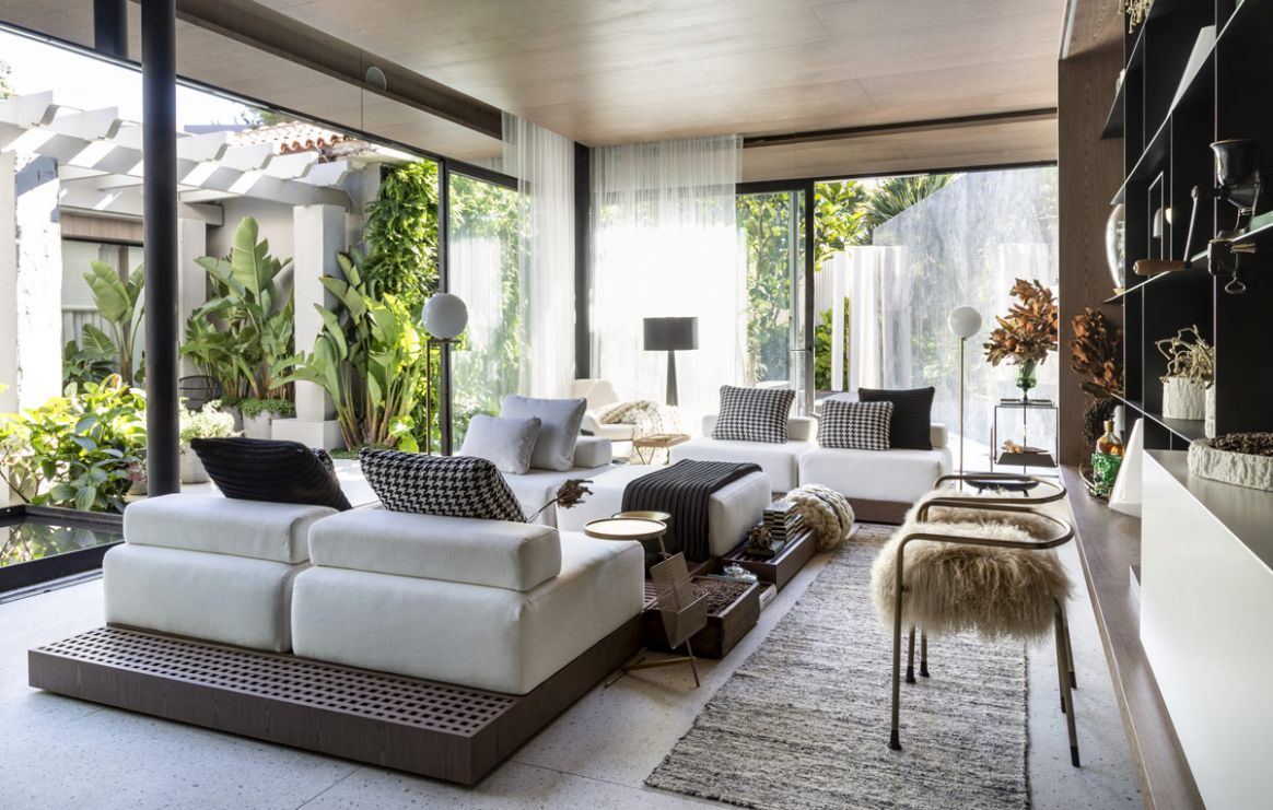 Small Open Plan Home With Jungle-Like Botanical Decor