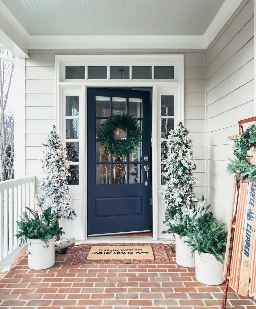 Southern front porch decorated for winter and Christmas with a ..