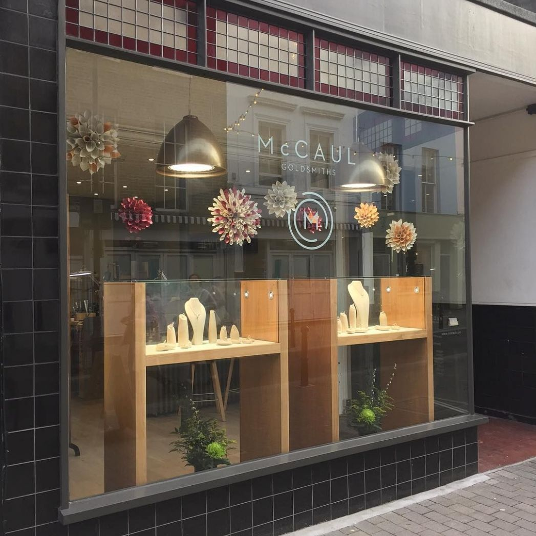 Spring has sprung and our seasonal window display is hung! #paper ...