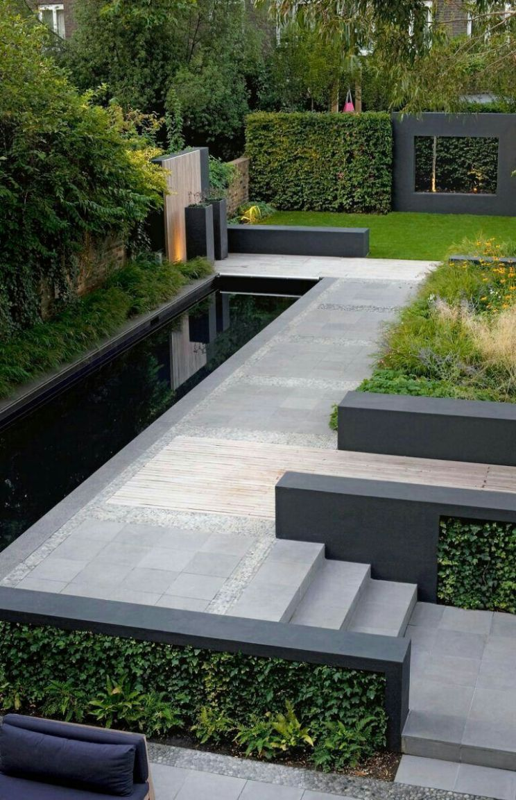 Striking modern garden landscaping in black and grey...Love it ...