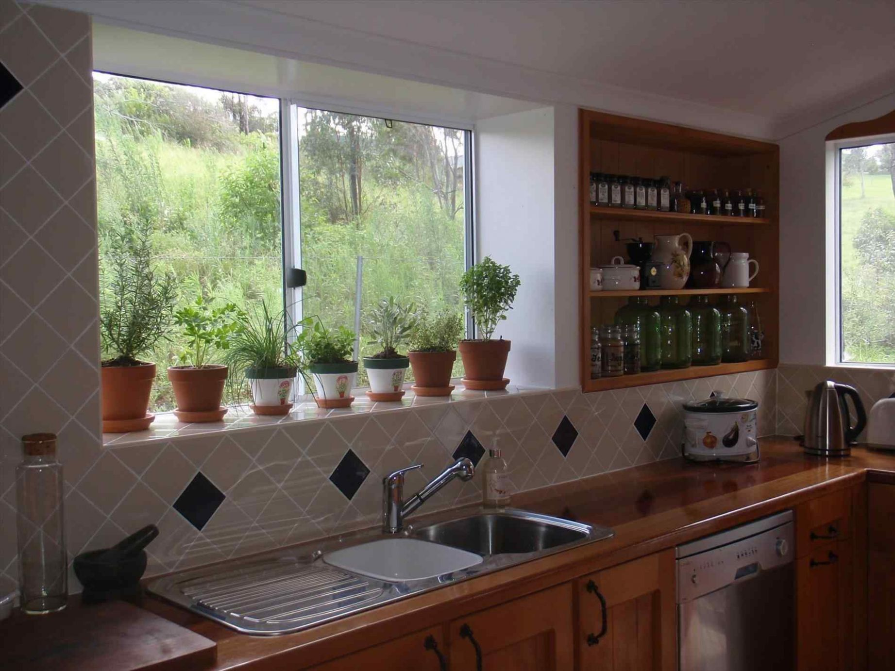 Style up the Window Ledge Space with These Stunning Ideas - window sill ideas kitchen
