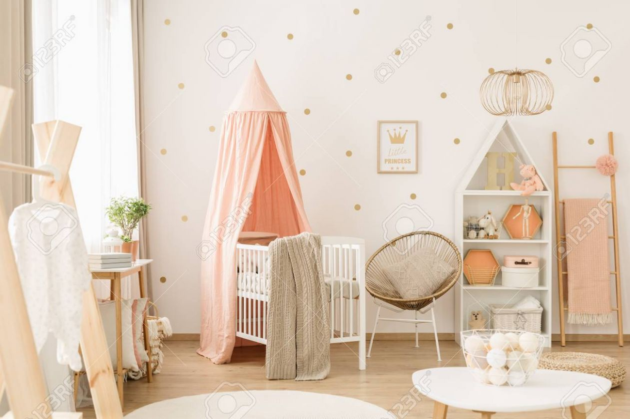 Sweet, spacious nursery room interior for a baby girl with white.