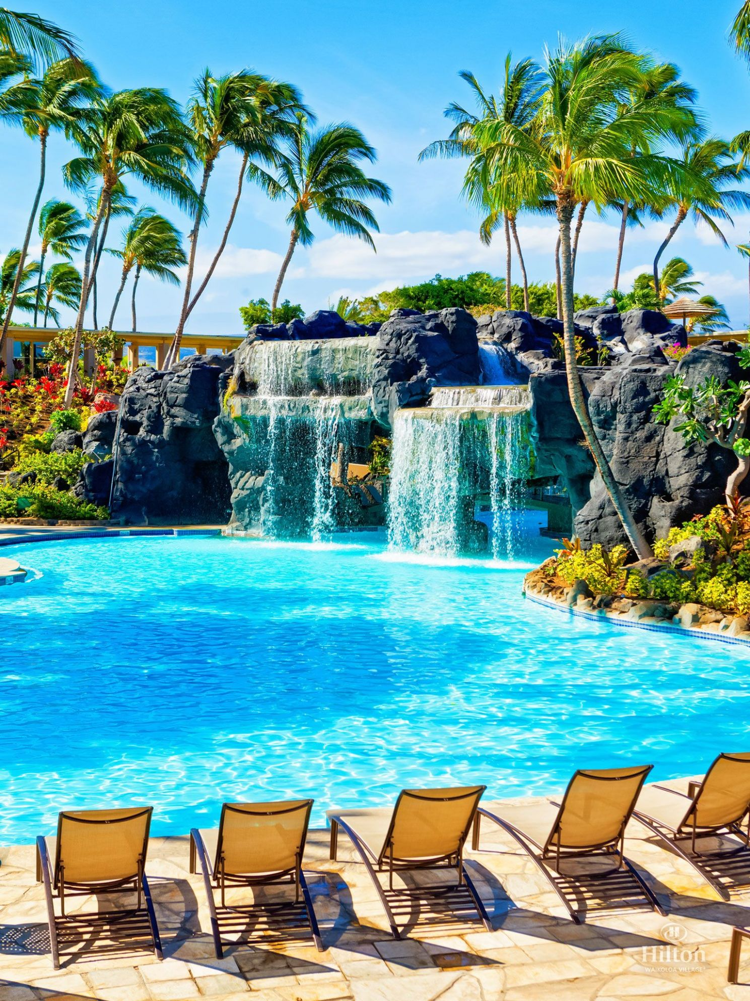 Swim under the waterfall to reach the water slide and whirlpool at ..