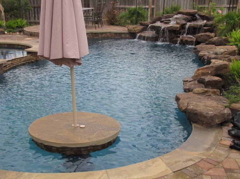 Swimming pool with table and umbrella- www.geremiapools.com We can ..