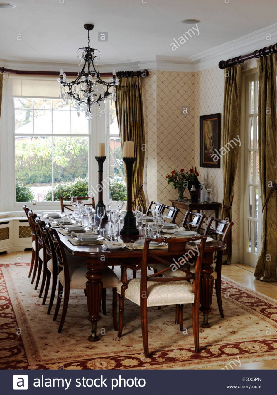 Table and chairs in traditional dining room, UK home Stock Photo ...
