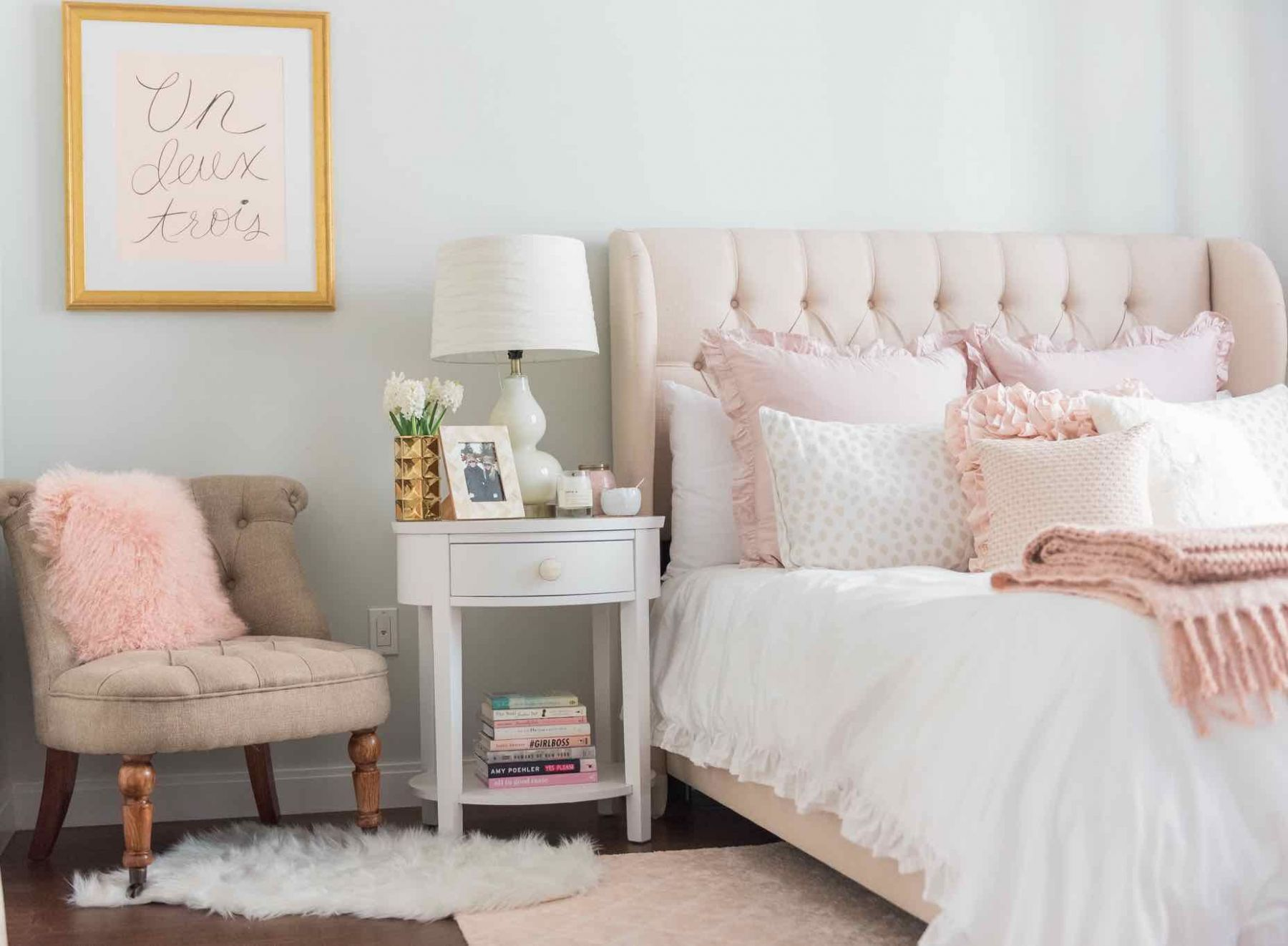 This lush pink bedroom is flushed with soft details including a ...