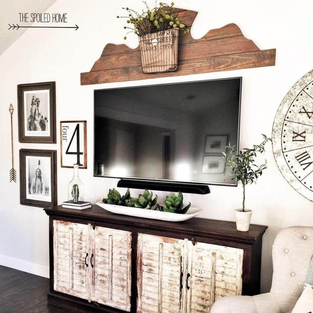 TV Area with Native American Photos | Wall decor living room ...