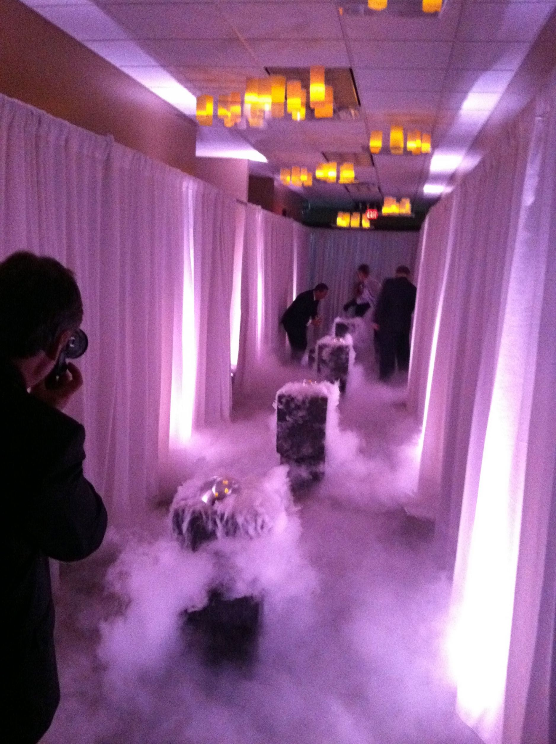 Use dry ice to create the smoke. Very cool for s party or wedding ..