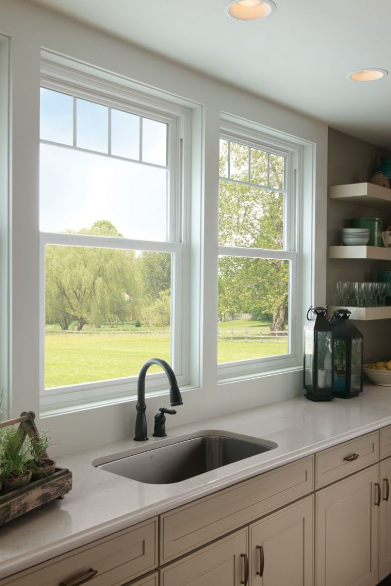 Valence grids give these kitchen sink windows a new sophistication ..